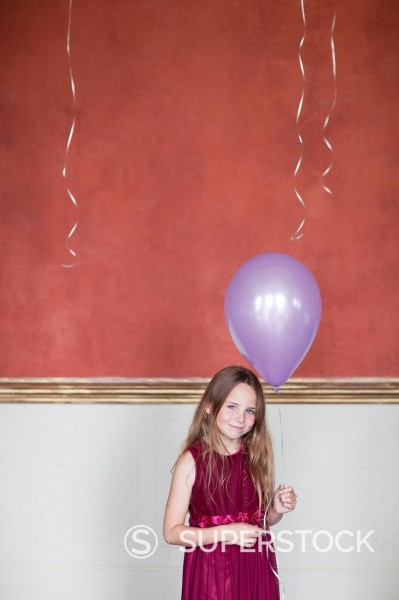Portrait of smiling girl with balloon : Stock Photo