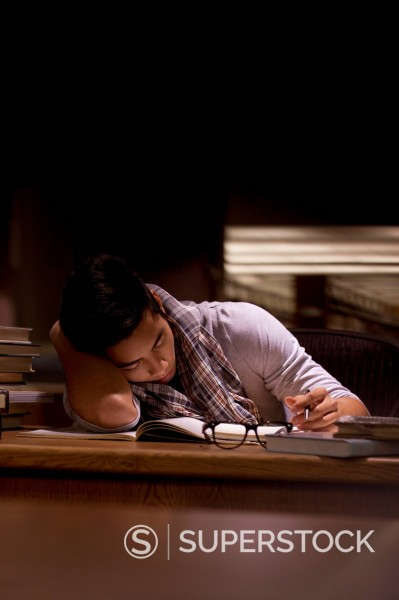 Stock Photo: 1775R-28045 Student working in library at night