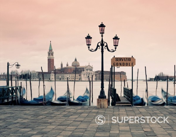 Gondolas docked in urban pier : Stock Photo