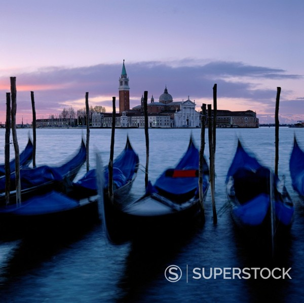 Stock Photo: 1775R-28518 Time lapse view of gondolas docked in urban pier
