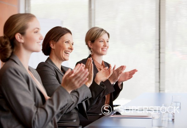 Stock Photo: 1775R-28653 Businesswomen clapping in conference room