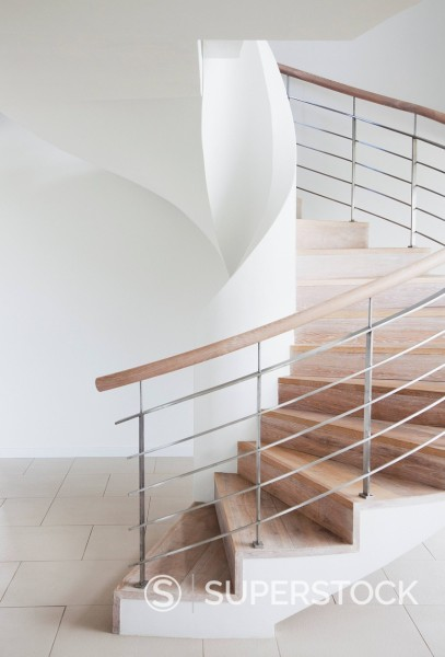 Curving, wooden staircase : Stock Photo