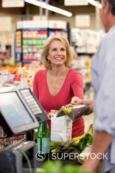 Stock Photo: 1775R-29403 Woman buying groceries at supermarket