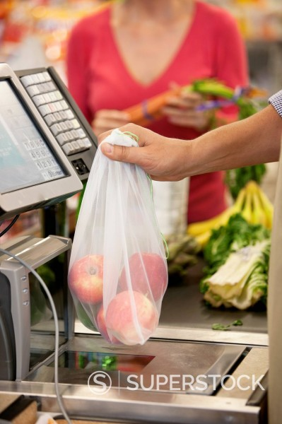Stock Photo: 1775R-29413 Cashier ringing up groceries in supermarket