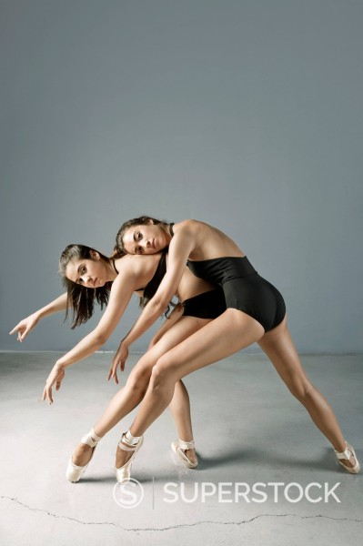 Stock Photo: 1775R-29641 Ballet dancers posing on pointe