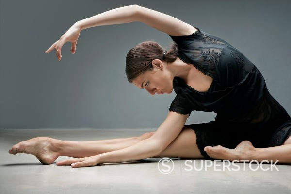 Stock Photo: 1775R-29937 Dancer stretching on floor