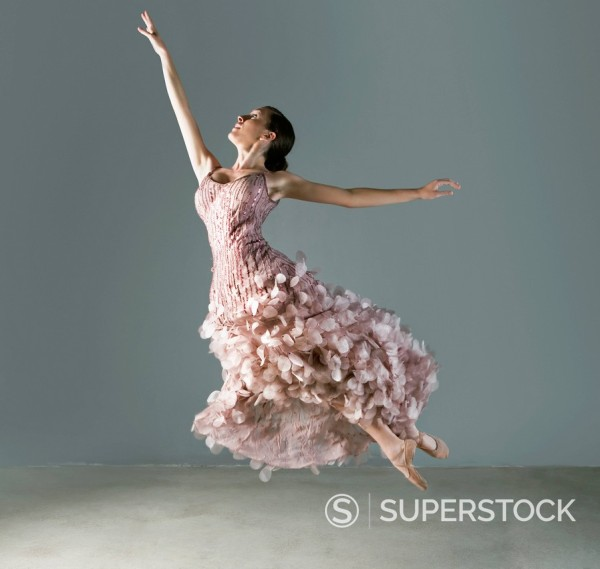 Ballet dancer posing in ornate gown : Stock Photo