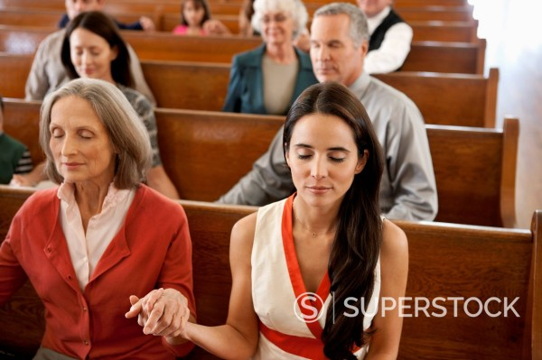 Stock Photo: 1775R-30063 Congregation holding hands in prayer