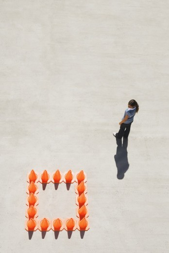 Woman outside box of traffic cones : Stock Photo