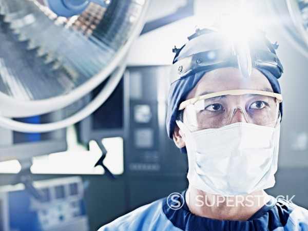 Close up of surgeon wearing headlamp : Stock Photo