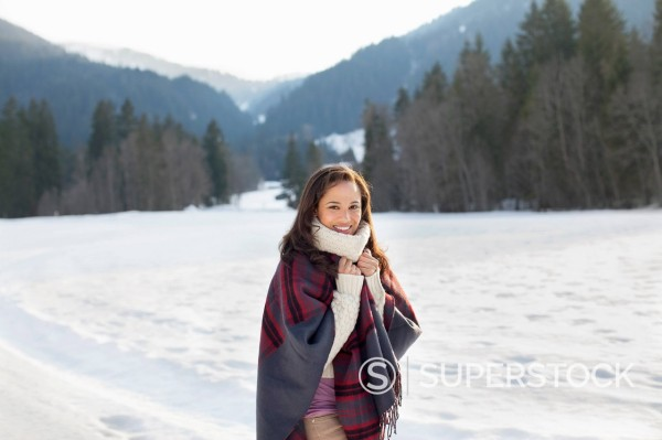 Portrait of smiling woman in snowy field : Stock Photo