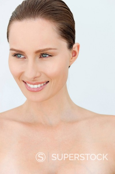 Close up portrait of smiling woman with bare chest : Stock Photo