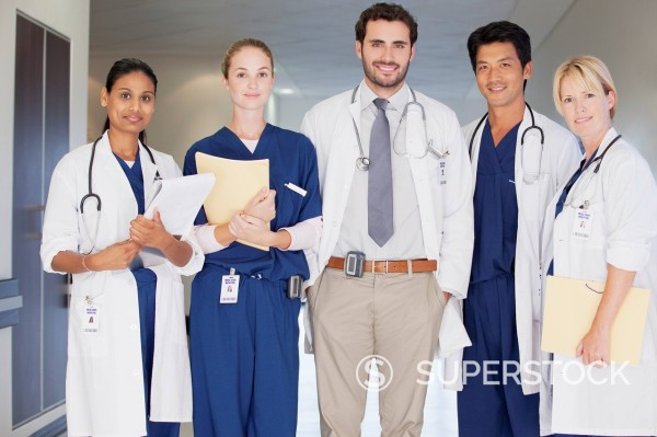 Stock Photo: 1775R-30363 Portrait of smiling doctors and nurse in hospital corridor