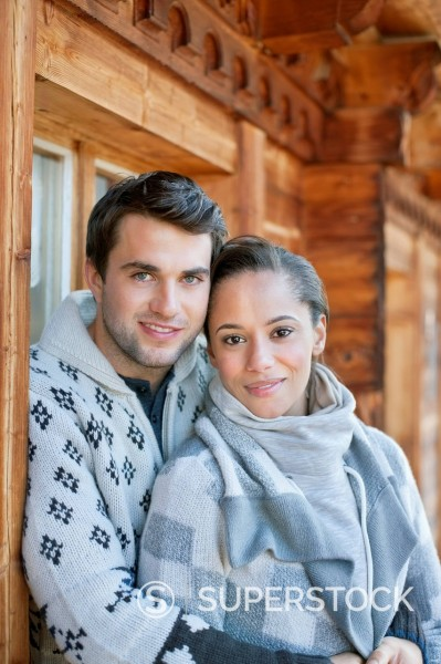 Stock Photo: 1775R-30367 Portrait of smiling couple hugging on cabin porch