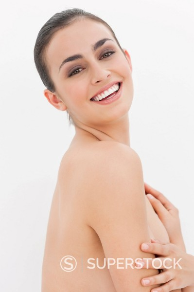 Stock Photo: 1775R-30397 Close up portrait of smiling woman with bare chest