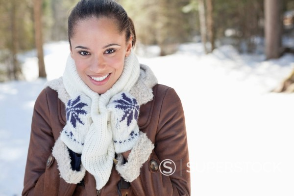 Stock Photo: 1775R-30408 Portrait of smiling woman in snowy woods