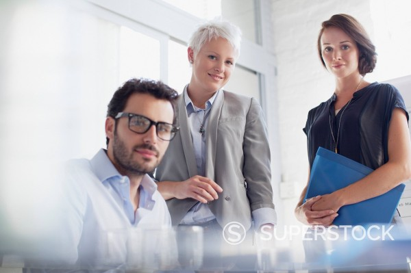 Stock Photo: 1775R-30456 Portrait of confident business people in office
