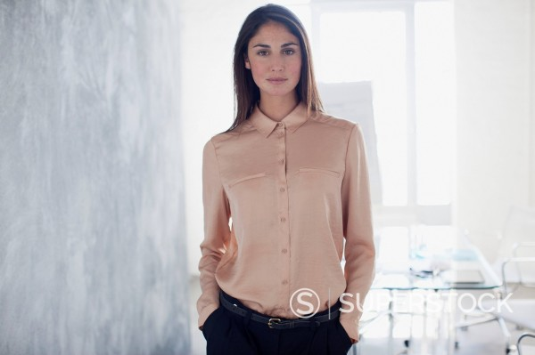 Stock Photo: 1775R-30457 Portrait of confident businesswoman with hands in pockets