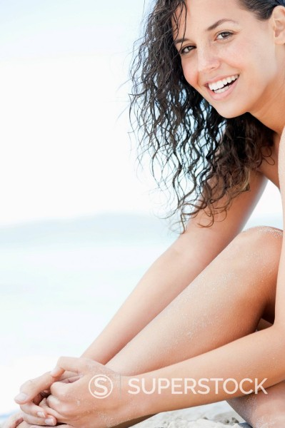 Stock Photo: 1775R-30493 Portrait of smiling woman at beach