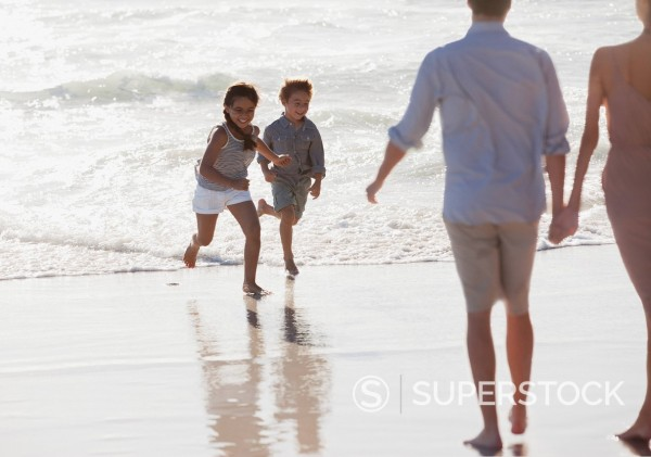 Family on sunny beach : Stock Photo