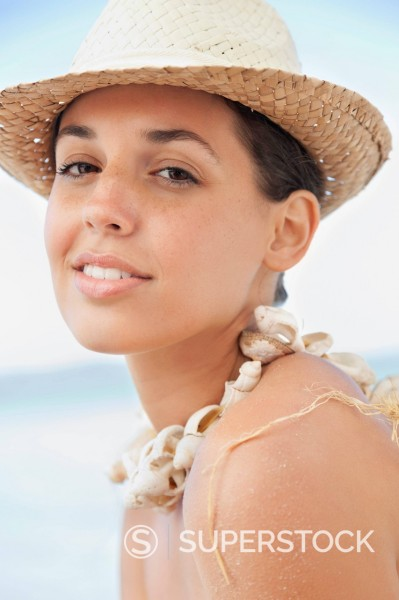 Stock Photo: 1775R-30531 Close up portrait of smiling woman in sun hat at beach
