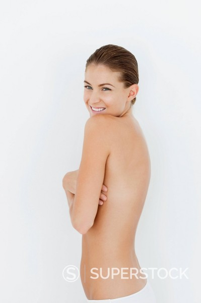 Portrait of smiling woman standing with bare chest : Stock Photo
