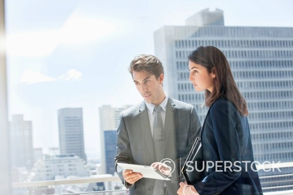 Stock Photo: 1775R-30579 Businessman and businesswoman with digital tablet on urban balcony