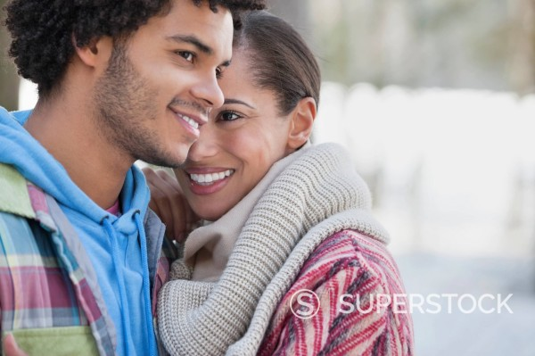 Close up portrait of couple hugging outdoors : Stock Photo