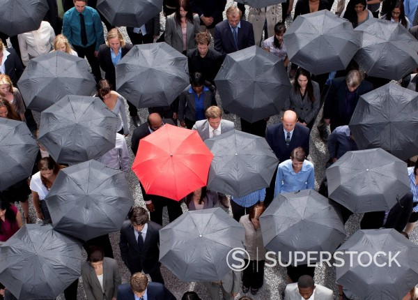 Stock Photo: 1775R-30609 Red umbrella standing out in crowd of business people