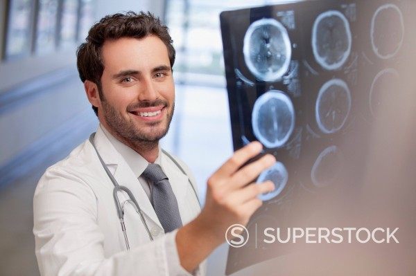 Stock Photo: 1775R-30614 Portrait of smiling doctor holding x_ray in hospital corridor