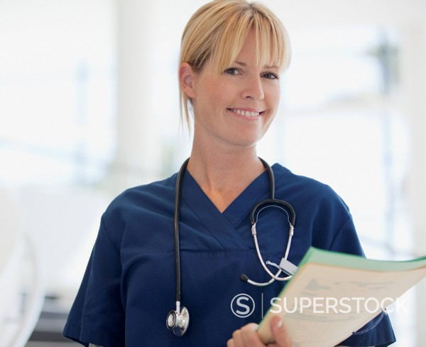 Stock Photo: 1775R-30617 Portrait of smiling nurse holding medical record