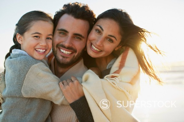 Stock Photo: 1775R-30642 Portrait of smiling family on sunny beach