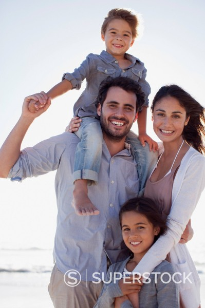 Portrait of smiling family on beach : Stock Photo