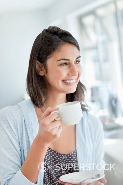 Stock Photo: 1775R-30707 Smiling woman drinking coffee