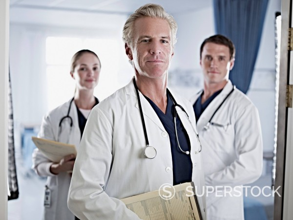 Portrait of confident doctors in hospital room : Stock Photo