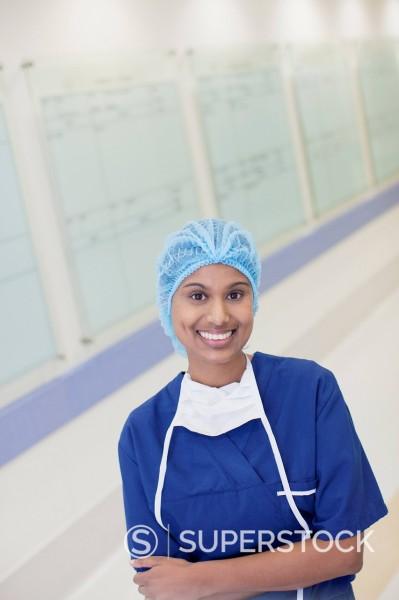 Portrait of smiling nurse in hospital corridor : Stock Photo