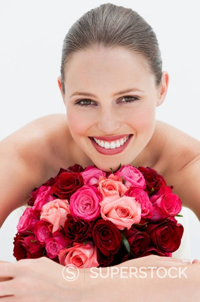 Stock Photo: 1775R-30792 Close up portrait of smiling woman with bouquet of roses