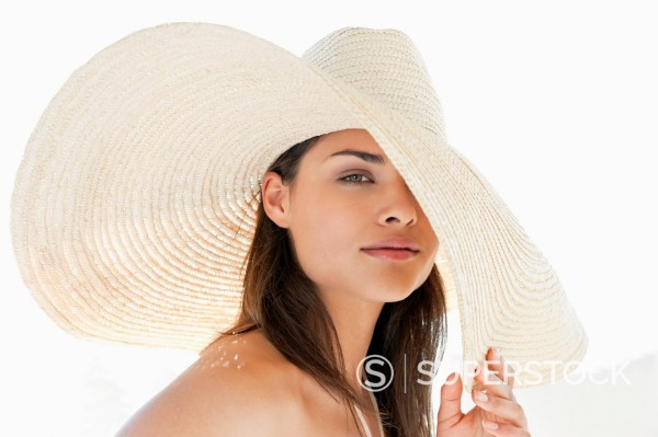 Stock Photo: 1775R-30798 Portrait of woman wearing large sun hat