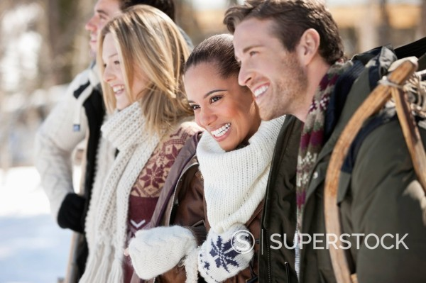 Stock Photo: 1775R-30811 Smiling couples with sled