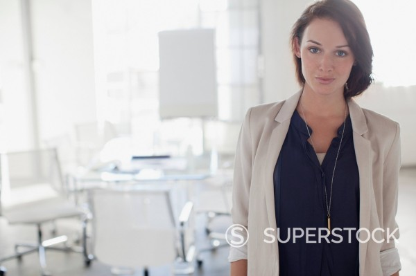 Stock Photo: 1775R-30813 Portrait of confident businesswoman in office