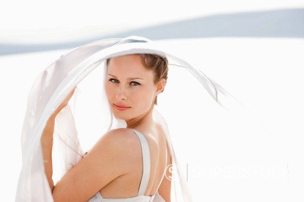 Portrait of woman under fabric : Stock Photo