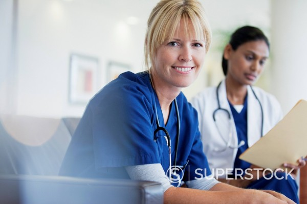 Stock Photo: 1775R-30895 Portrait of smiling nurse sitting with doctor in hospital