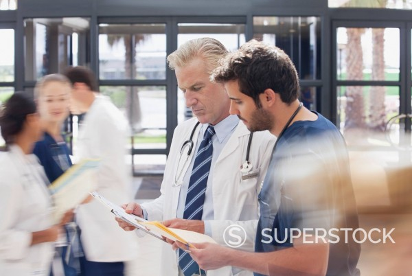 Stock Photo: 1775R-30919 Doctor and nurse reviewing medical record in hospital