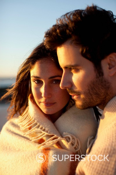 Stock Photo: 1775R-30968 Close up portrait of couple hugging on beach