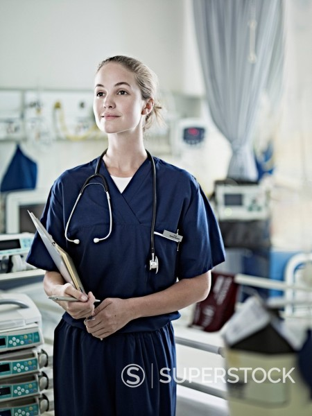 Stock Photo: 1775R-30973 Portrait of confident nurse in hospital room