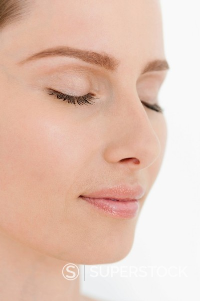 Close up of woman with eyes closed : Stock Photo