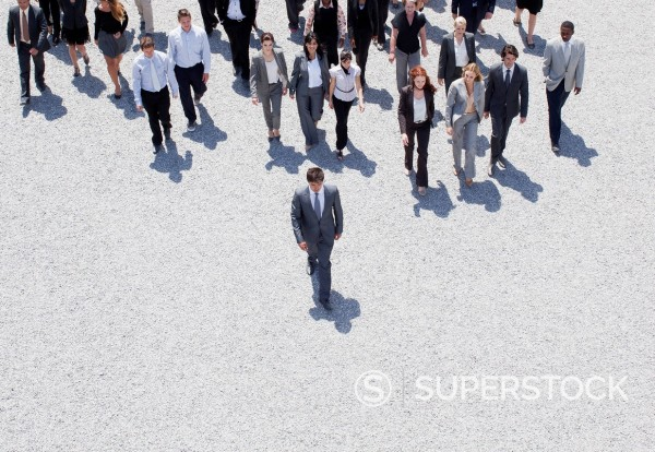 Stock Photo: 1775R-30989 Businessman leading business people