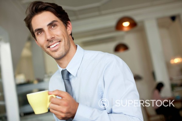 Stock Photo: 1775R-31016 Smiling businessman drinking coffee