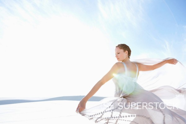 Stock Photo: 1775R-31031 Woman spinning in dress