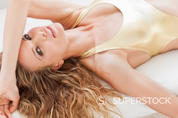 Stock Photo: 1775R-31036 Portrait of woman in bathing suit laying on towel